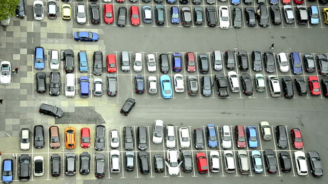 lot of cars parking in a city video