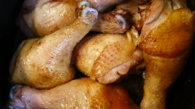 A lot of chicken legs boiling video