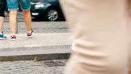 istock Lot of feet a crowd of people strolling along the cobbles of the city 871202826