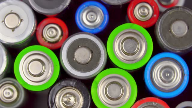 lot of old used batteries, view from above