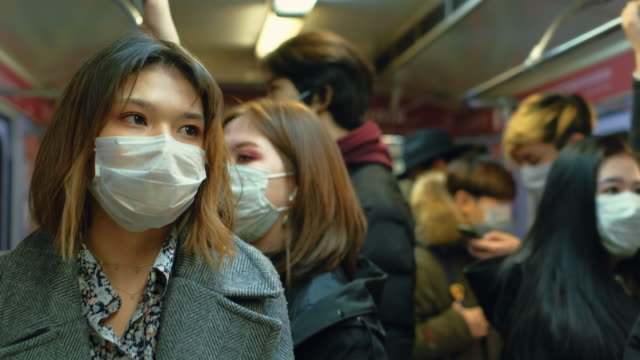 A lot of people in public transport. Bus or subway train. Many Crowds in Mask. video