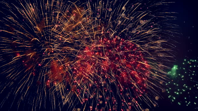 Lots of colorful bursts in a night sky. Multicolored fireworks burst, during a patriotic holiday. Multicolored fireworks burst, during a patriotic holiday. circa 4th century stock videos & royalty-free footage
