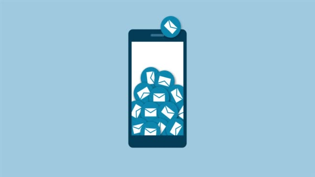 lots of e-mails falling into a smartphone - newsletter video stock e b–roll