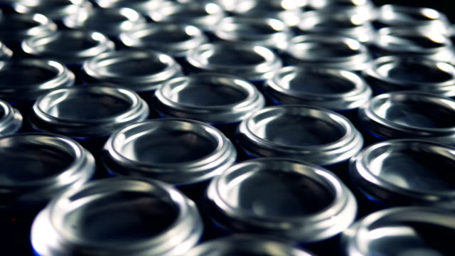 Lots of metal aluminum cans on a conveyor.