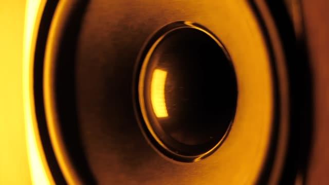 LoudSpeaker in Action. Thumping bass audio-speaker. Orange neon led light. Slow motion LoudSpeaker in Action. Thumping bass audio-speaker. Orange neon led light. speaker stock videos & royalty-free footage