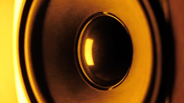 vídeos de stock e filmes b-roll de loudspeaker in action. thumping bass audio-speaker. orange neon led light. slow motion - orador público