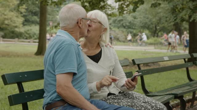 love bench smartphone seniors social media new york surfing net - bench stock videos & royalty-free footage
