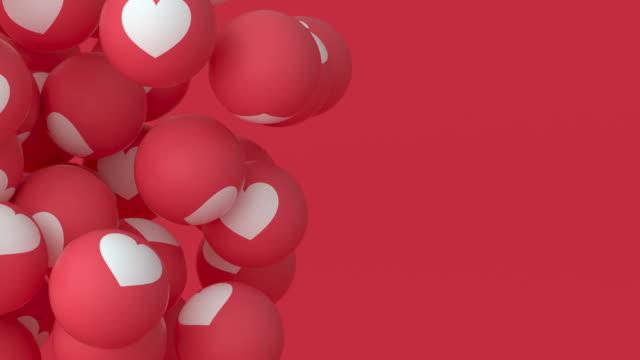 "palle emoji ""amore"" - floating #3 (a sinistra) - icona mi piace video stock e b–roll"