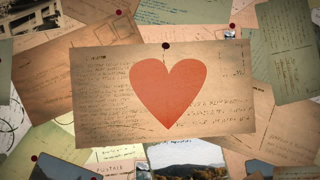 Love letter with a heart is pinned to a pin board with vintage postcards