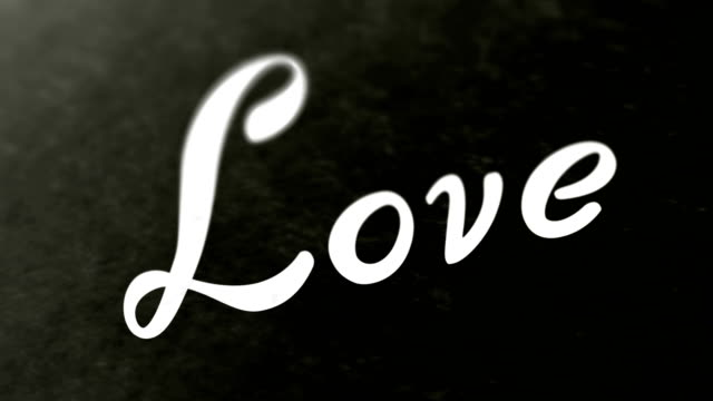 """""""love"""" on the page. looping footage has 4k resolution. - simbolo concettuale video stock e b–roll"""