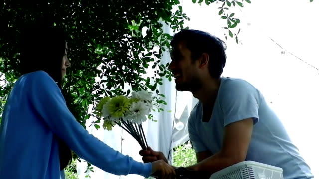 Love, romance and flowers.Man making proposal to woman with flower for wedding.HD format. video