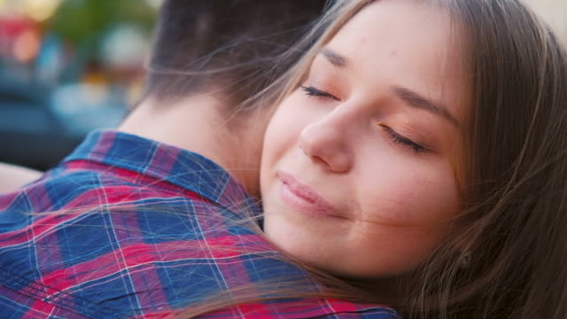 love sincere feelings emotion couple hug street - chiedere scusa video stock e b–roll