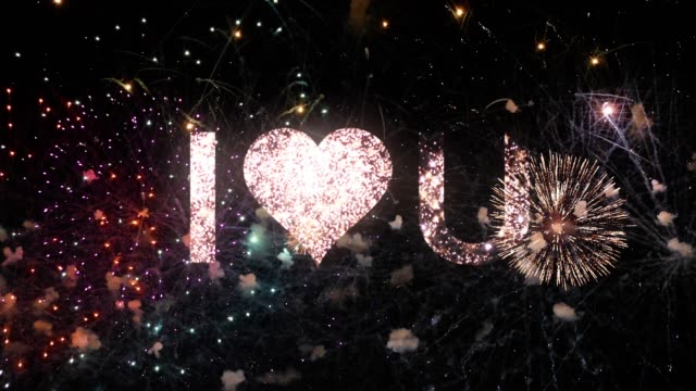 I love you message in the sky with fireworks and sparks on black night sky with heart logo, typography design - Event concept