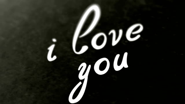 """""""i love you"""" on the page. looping footage has 4k resolution. - simbolo concettuale video stock e b–roll"""