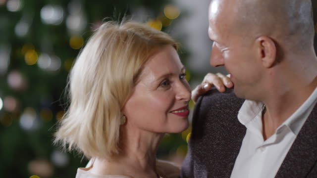 Loved-Up Caucasian Couple Dancing Together at Christmas Party