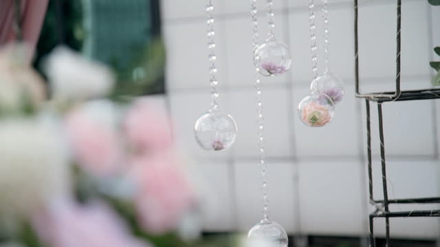 lovely composition of flowers in glass balls capture imagination - дворец спорта стоковые видео и кадры b-roll