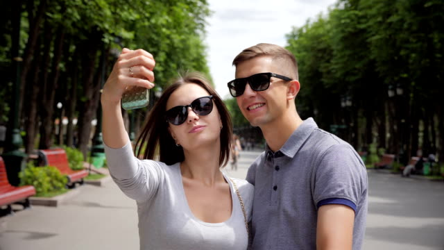 Lovely couple doing selfie photo video