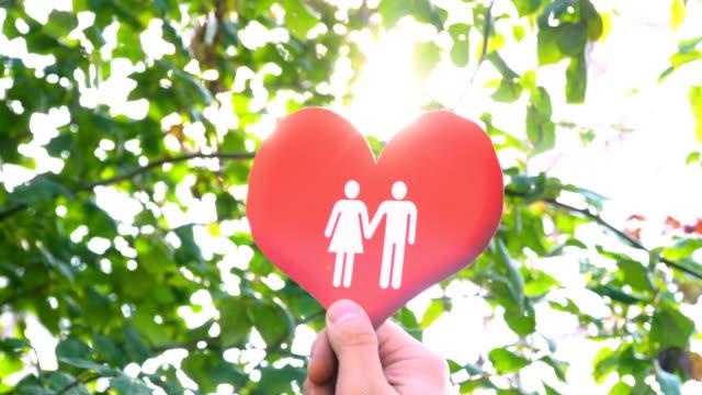 Lovely Couple Icon on Heart Shape