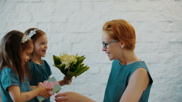 lovely daughters give mom a gift and flowers video