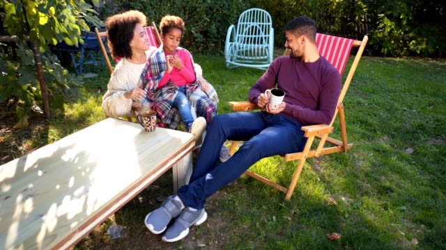 Lovely family enjoying a day in a back yard