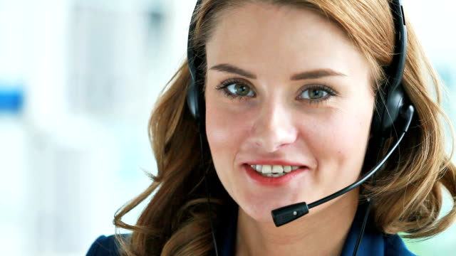Lovely receptionist Charming girl consulting clients by the phone or online, good for ads and commercials hands free device stock videos & royalty-free footage
