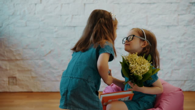 lovely sisters give themselves flowers and a gift video