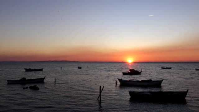 lovely sunset with boats on the sea fisherman's boats on the sea in the sunset aegean turkey stock videos & royalty-free footage