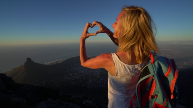 Loving Cape Town Young woman makes heart shape with hands on Table Mountain table mountain national park stock videos & royalty-free footage