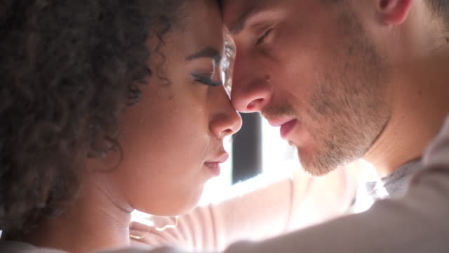 Loving couple face to face with eyes closed video
