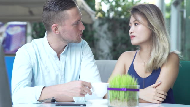Loving couple flirting while drinking coffee video