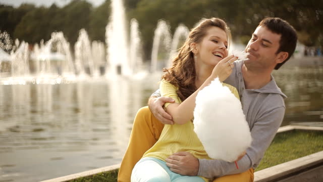 loving couple in the park fed each other's cotton candy video