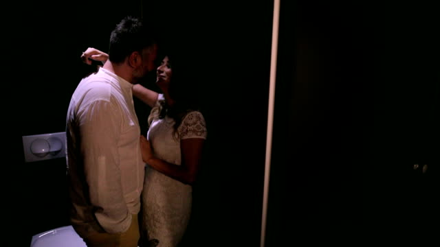 Loving couple kissing in the toilet video