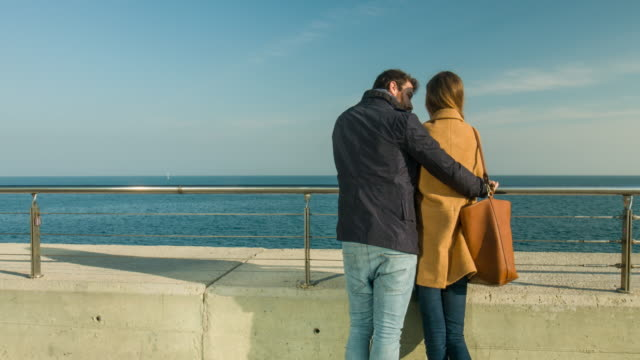 Loving couple looking at the sea view. video