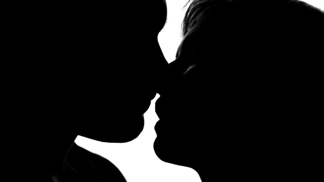 loving couple passionately kissing on romantic date, relationship and love - seduzione video stock e b–roll