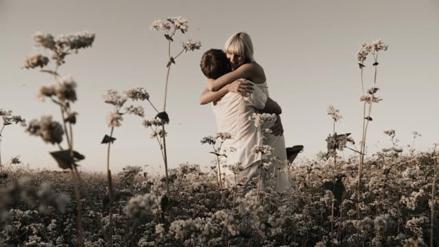 HD SLOW-MOTION: Loving Couple Twirling In Buckwheat Field