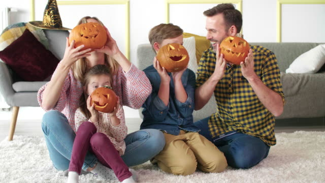Loving family with halloween pumpkins