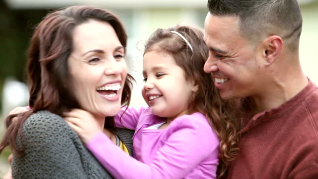 loving hispanic family with little girl, hugs and kisses - 2 3 anni video stock e b–roll