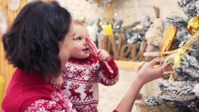 Loving mother and baby daughter celebrating Christmas video