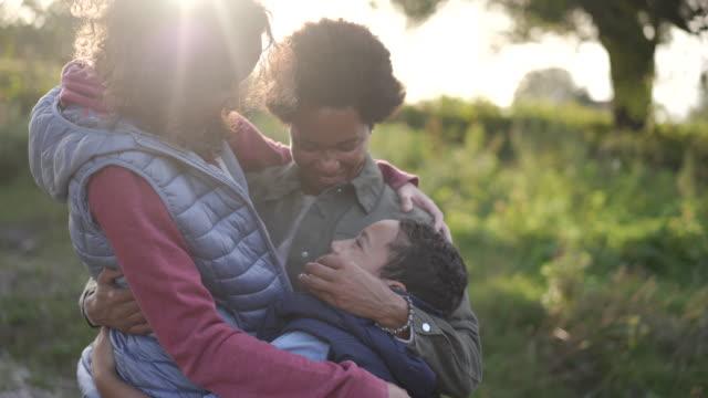 Loving mother hugging her children