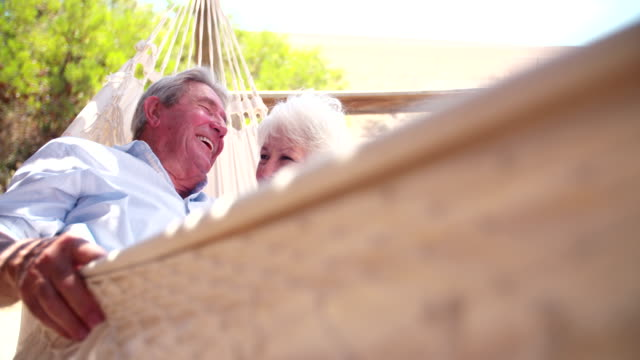 Loving retired senior couple laughing together video