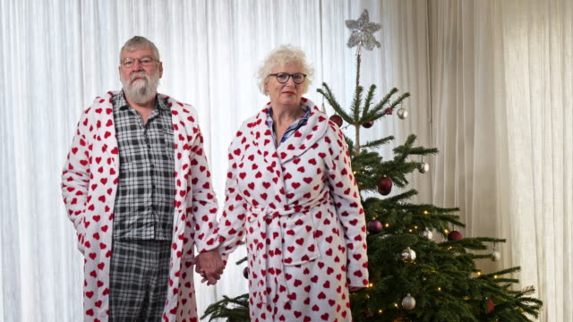 loving senior couple are kissing, christmas - moglie video stock e b–roll