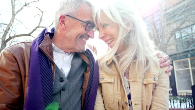 Loving senior couple enjoy time together outdoors