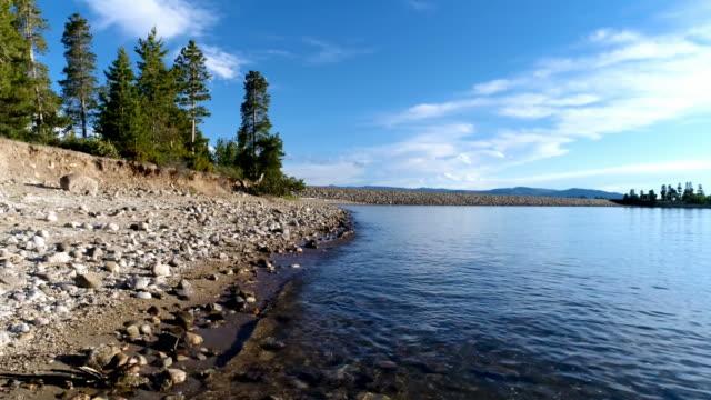 Low angle drone POV of Colorado mountain reservoir shoreline video