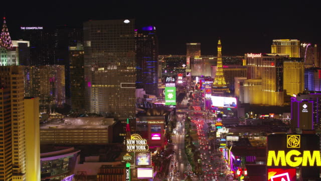 low angle fly over las vegas strip at night. - nevada video stock e b–roll