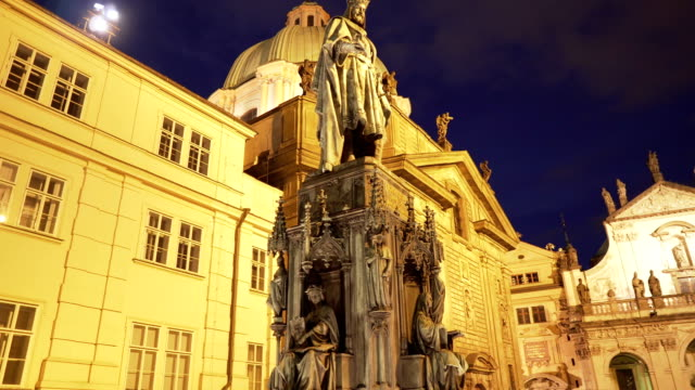 low angle handheld view: the monument to king charles iv in prague at night - renaissance architecture stock videos & royalty-free footage