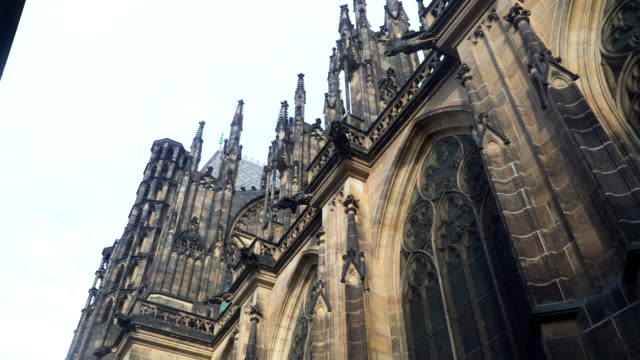 low angle handheld view: walking around St. George's Basilica, Cathedral Church,  Prague low angle handheld view: walking around St. George's Basilica, Cathedral Church,  Prague neo gothic architecture stock videos & royalty-free footage