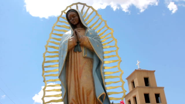 Low Angle of a Statue of the Virgin Guadalupe with an Adobe Catholic Church video