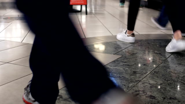Low angle shot of people walking at food court area video