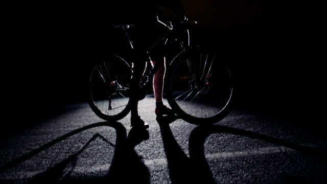 Low angle slow motion silhouette shot of cyclist posing video