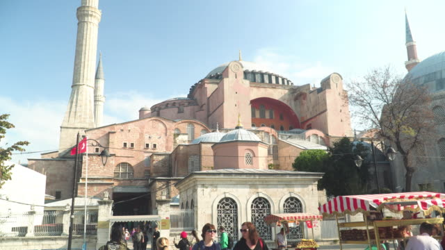 low angle view during walking on entrance the street to see national landmark:  building exterior of the Mosque in Istanbul- Hagia Sophia Mosque, a religious symbol and Turkish culture under the white sky in the morning in Istanbul, Turkey.